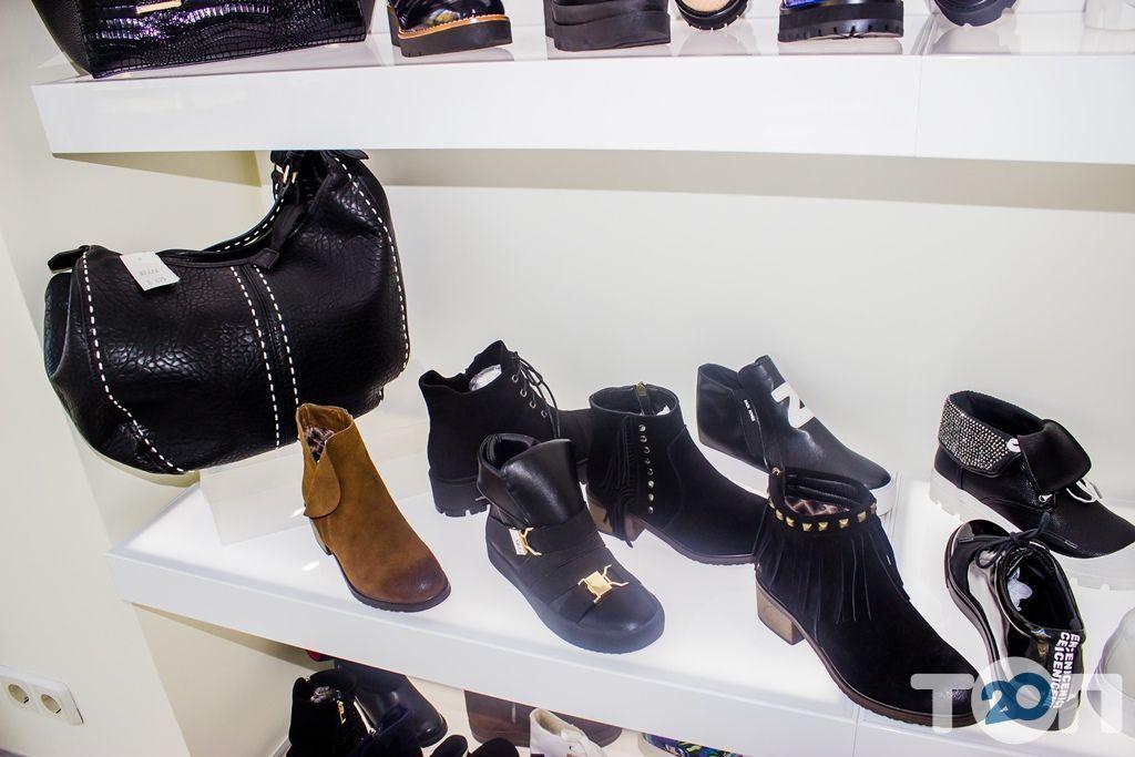 4 сезони, магазин взуття - фото 25
