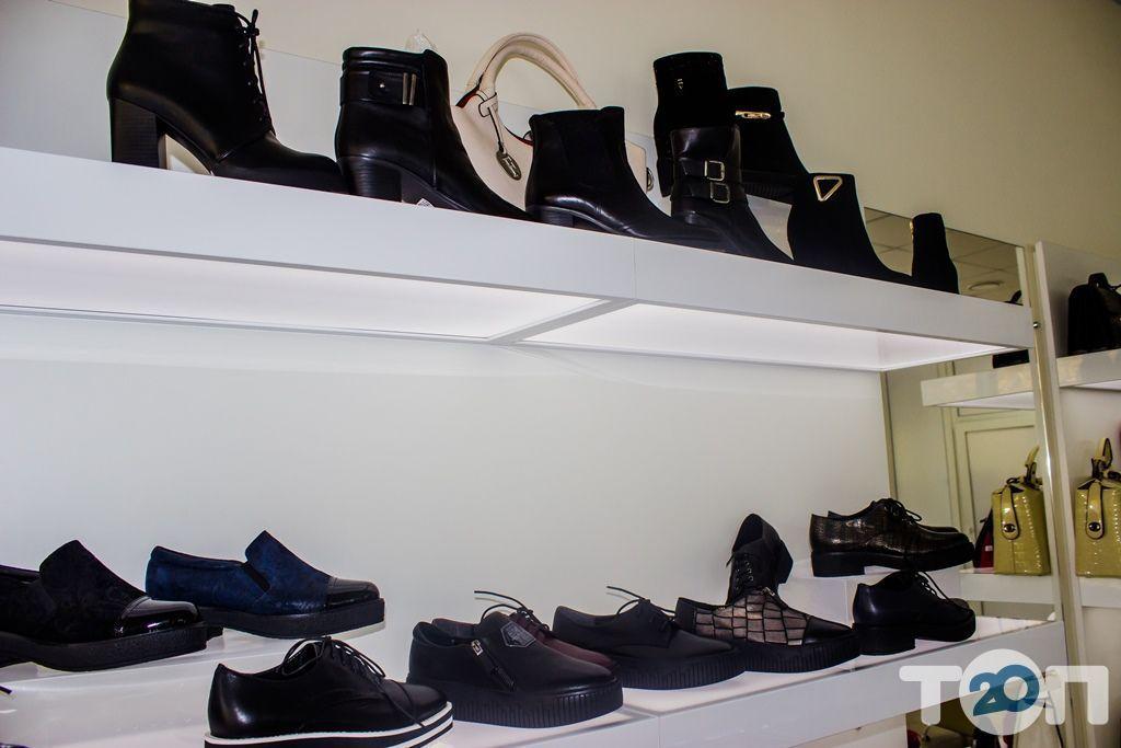 4 сезони, магазин взуття - фото 27