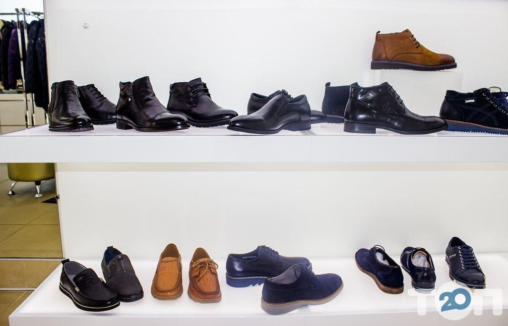 4 сезони, магазин взуття - фото 36