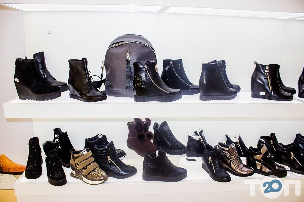 4 сезони, магазин взуття - фото 44
