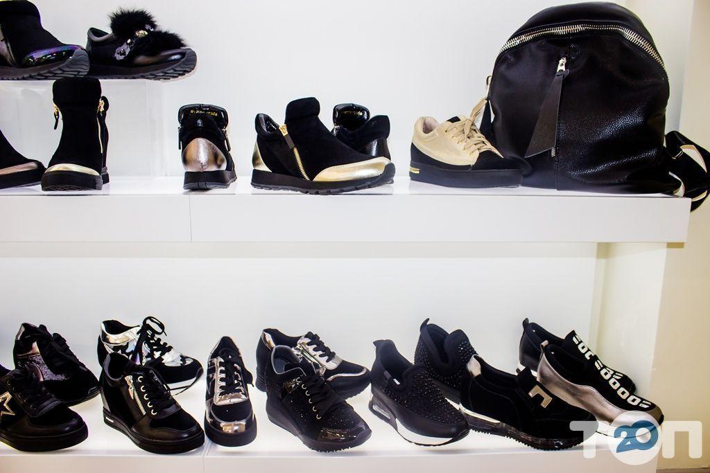 4 сезони, магазин взуття - фото 46
