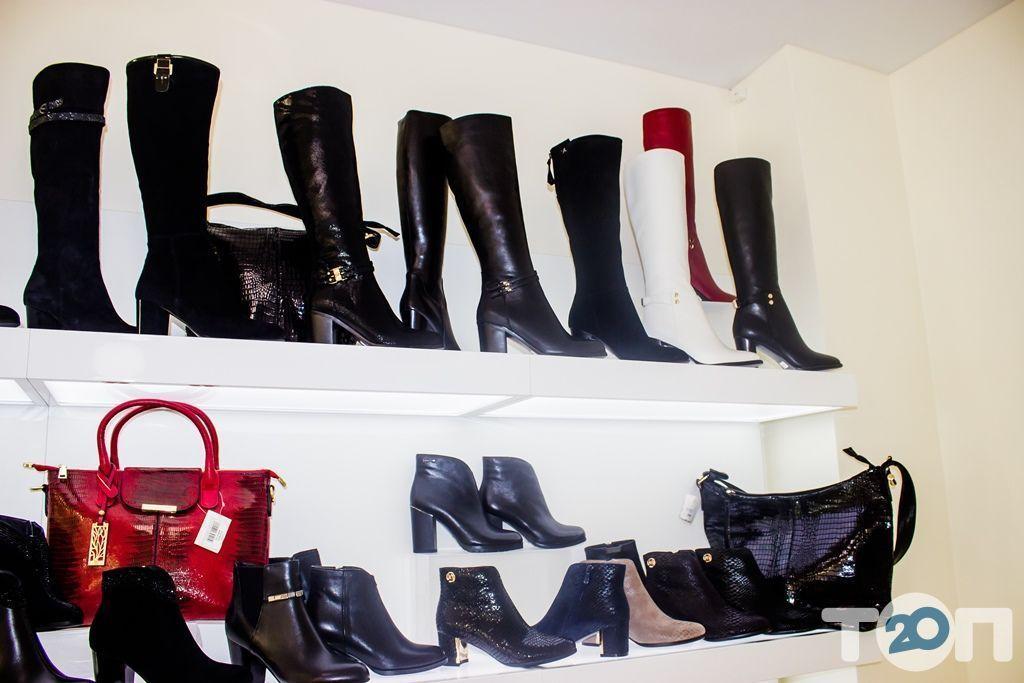 4 сезони, магазин взуття - фото 47