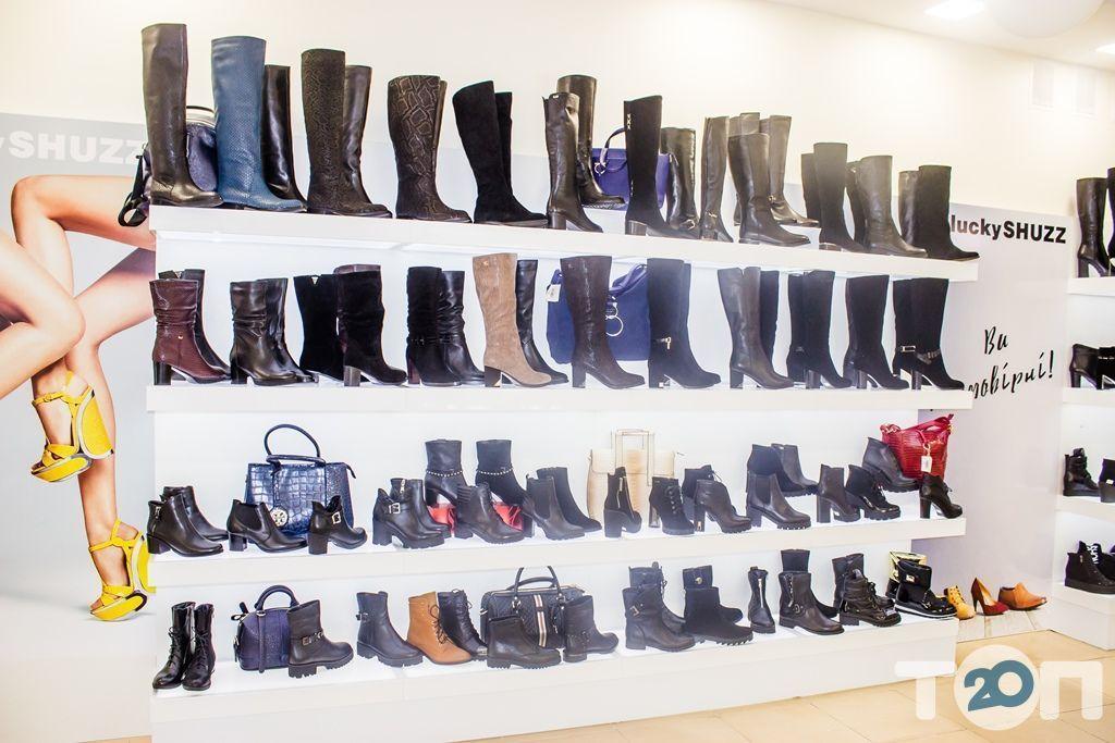 4 сезони, магазин взуття - фото 49