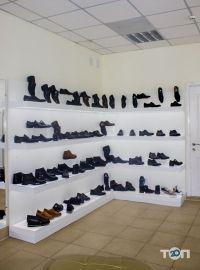 4 сезони, магазин взуття - фото 6