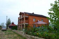 Деревянные домики на берегу Днестра - фото 1