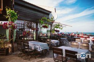 Santorini, кафе на берегу моря Санторини - фото 3