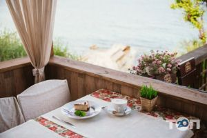 Santorini, кафе на берегу моря Санторини - фото 4